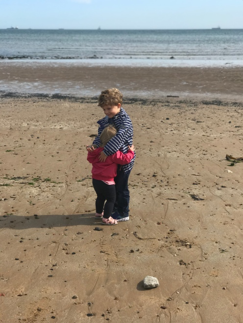 Forced hug @ Aberdeen Beach