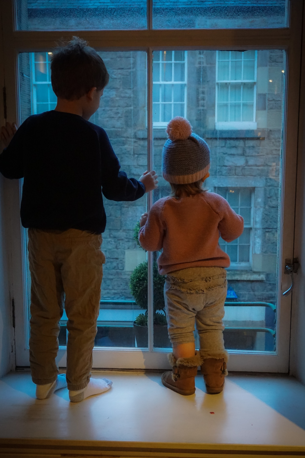 Brooks and Mia looking out the window of our flat