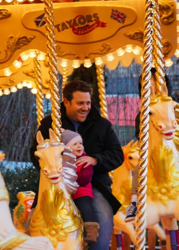 Brett and Mia on the carousel